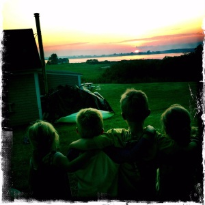 Kids in silhouette at sunset