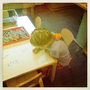 writing her name in yellow
